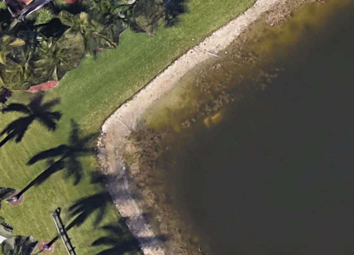 Screenshot von Google Earth zeigt das Autowrack im See