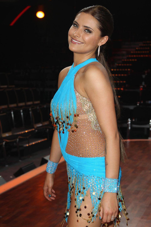 """2010  Strahlend schön posiert die damals 21-Jährige hier für die Fotografen der TV-Show """"Let's Dance"""". Zusammen mit ihrem Tanzpartner Massimo gewinnt sie die Staffel."""
