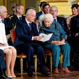 König Albert und Königin Paola studieren, bevor es richtig los geht, das Geburtstagsprogramm.