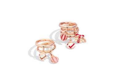 Mit diesen wunderschönen Ringen von Dodo können Sie Weihnachten wohl jeden um den Finger wickeln. Spaltring aus Roségold mit Kugelanhänger aus Roségold mit Emaille und Glitter, ca. je 415 Euro. Spaltring mit Paketanhänger, ca. 435 Euro.