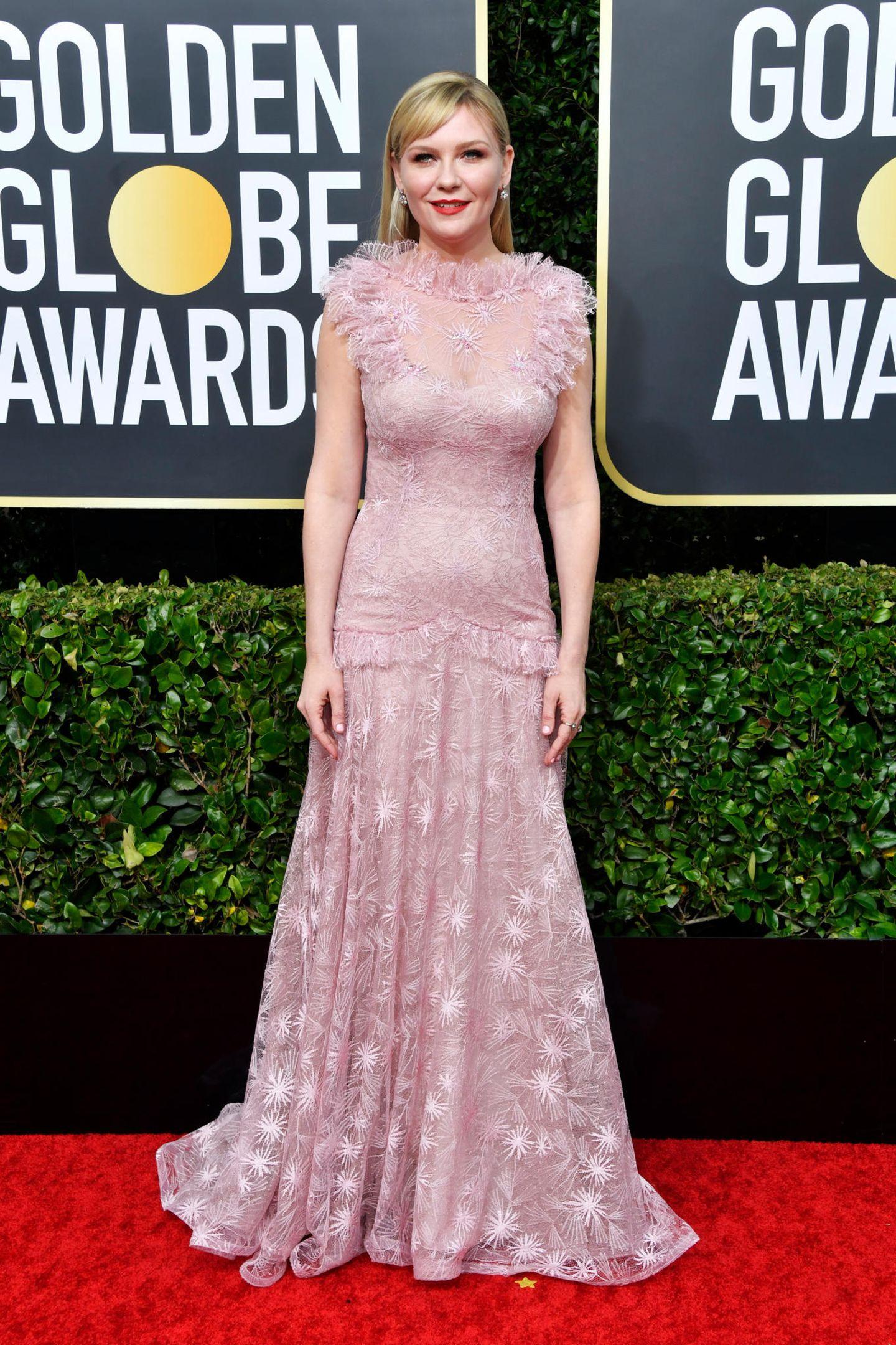 Kirsten Dunst im romantischen Rosa-Look. Ihr Spitzenkleid ist eine Handanfertigung von Rodarte.