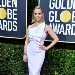 Reese Witherspoon bezaubert auf dem roten Teppich im eleganten, weißen Look von Roland Mouret.