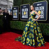 Flower Power: Taylor Swift bringt mit ihrer Robe von Etro Frühlingsstimmung auf den roten Teppich der 77. Golden Globes.