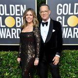 Rita Wilson im schwarzgoldenen Glitzer-Look und Tom Hanks im Tuxedo gehören zu den Glamour-Paaren des Abends.