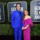 Diese beiden Stars mögen's knallig: Isla Fisher und Sacha Baron Cohen.