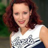 """1998  Als Cheerleader der Hamburger """"Blue Angels""""-Football-Mannschaft hat Blümchen ihre ersten Auftritte vor größerem Publikum. Für einen Auftritt in der """"Mini Playback Show"""" schlüpft sie erneut in die Uniform."""