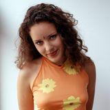 """1997  Zwei Jahre nach ihrem Durchbruch mit """"Herz an Herz"""" zählt """"Blümchen"""" in Deutschland zu den Chartstürmern. Die damals 17-Jährige hat farbenfrohe Looks, die lockige Mähne und natürlich Blümchen zu ihrem Markenzeichen gemacht."""
