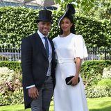 Neben den Royals zählen jedes Jahr auch internationale Stars zu den Gästen des spektakulären Pferderennens:Russell Wilson und Ciara haben sich in Schale geschmissen. Er trägt Frack und Zylinder, sie erscheint in einem weißen, eleganten Kleid und mit dunklen Accessoires.