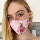 """Elle Fanning, die die Disney-Prinzessin Aurora in den """"Maleficent""""-Filmen spielt, hat für sich die passende Maske gefunden: das Dornröschen-Original."""