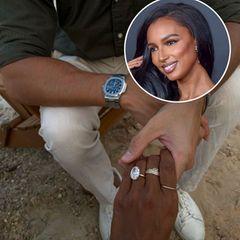 """Jasmine Tookes hat Ja gesagt! Nach vier Jahren Beziehung ist ihr Freund,Juan David Borrero, vor ihr mit diesem Mega-Ring auf die Knie gegangen. Dazu postet das """"Victoria's Secret""""-Model ein Foto von sich und ihrem Verlobten, wie sie vor traumhafter Felsenkulisse anstoßen."""