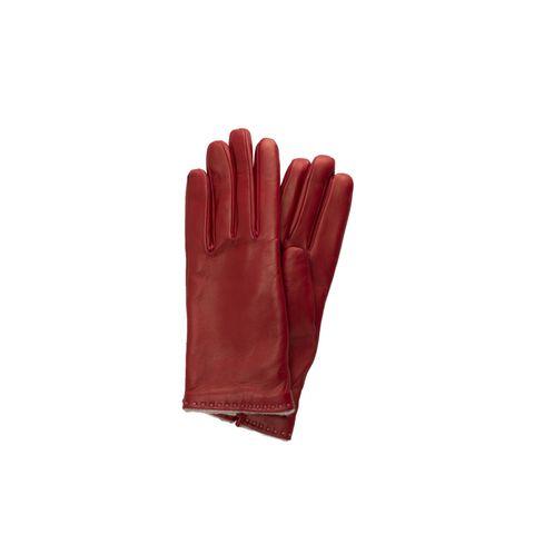 HandschmeichlerAus feinstem Leder gefertigt, verpassen die edlen Handschuhe in Rostrot unserem Winteroutfit die nötige Prise Glamour. Von Eterna, ca. 110 Euro