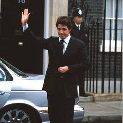 """Hugh Grant spielt in """"Love Actually"""" den frisch gewählten britischen Premierminister David, der sich in seine Angestellte verliebt."""