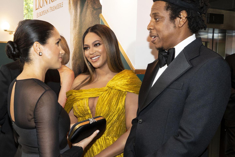 """Herzogin Meghan(l.) Beyoncé und Jay-Z bei der Premiere von """"König der Löwen"""" 2019 in London."""