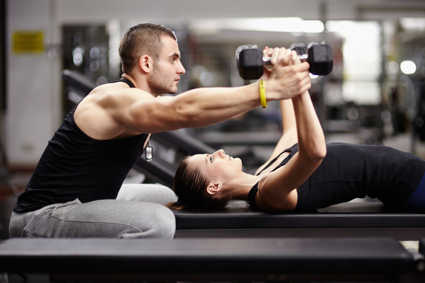 Sportmotivation: Frau mit Personal Trainer
