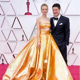 Passend zu den begehrten Gold-Trophäen an diesem Abend trägtCarey Mulligan ein aufregendes Valentino-Dress in schimmerndem Gold. An ihrer Seite strahlt Ehemann Marcus Mumford, der bezaubernde Diamantschmuck stammt von Cartier.