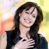 2003  Nach ihrer Scheidung von Billy Bob Thornton wurde Pony getragen. Zusammen mit ihrem strahlenden Lächeln.