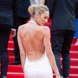 Bei der Eröffnungszeremonie sahCandice Swanepoel schon fantastisch aus. Und auch am zweiten Tag erscheint das Model in einem atemberaubenden Kleid von Etro mit tiefen Rückenausschnitt.