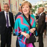 Angela Merkel lächelt in die Kamera des Fotografen.