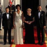 Joachim Sauer, Michelle Obama, Angela Merkel und Barack Obama posieren für ein Foto vor dem Weißen Haus.