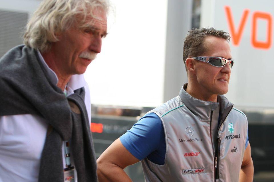 Dr. Johannes Peil und Michael Schumacher beim GrossenPreis Santander auf dem Hockenheimring im Juli 2012.