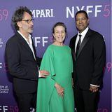 """NebenFrances McDormand im eleganten, aber knallig grünen Cape-Dress wirken Joel Coen und Denzel Washington bei der Eröffnungsfeier des 59. New Yorker Filmfestivalsund der Vorführung von """"The Tragedy Of Macbeth"""" fast unauffällig."""